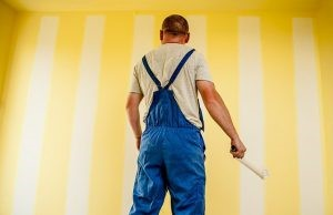 Painting a wall to ensure to get your security deposit back when moving out