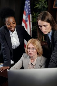 Female Lawyers in Office Looking at Computer